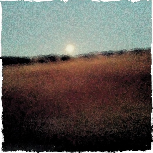 moonrise through a Photoshop filter.